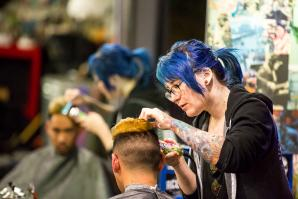 "When a new client hears his barber's name is Renee, he might envision an ""old French dude"" and not a young woman. The industry remains, after all, a field of men. ""When I was in school, it was me and 60 dudes,"" says Renee Green, 29 (pictured standing)."