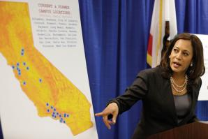 California Attorney General Kamala Harris points during a news conference to a display showing the location of Corinthian Colleges in California. 
