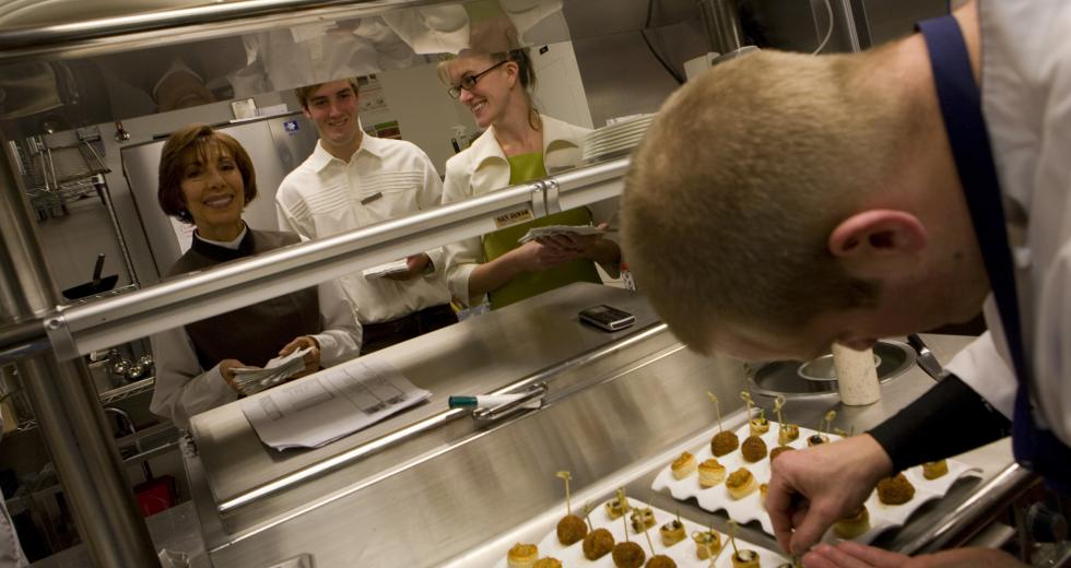 Kitchen staff plates hors d'oeuvres on the Ritz-Carlton's opening day
