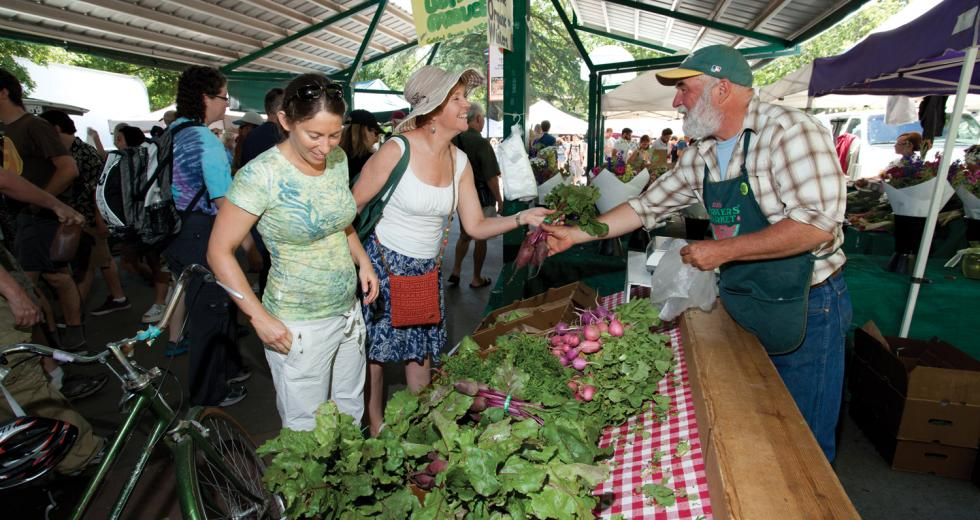 Customers browse the offerings at Davis's farmers market on Saturday afternoon.