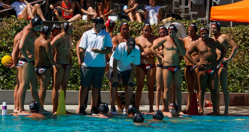 James Graham (white shirt, on right) coaches the men's water polo team at the University of the Pacific.