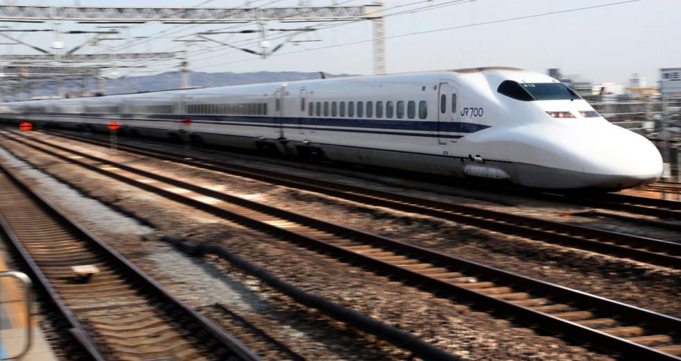 A Central Japan Railway Co. Shinkansen bullet train passes through Odawara Station, in Kanagawa Prefecture, Japan, on Monday, Jan. 25, 2010. Central Japan Railway Co., the owner of the nation's largest bullet-train maker, aims to sell high-speed trains in U.S. states including California and Texas as it strives to boost overseas sales. 