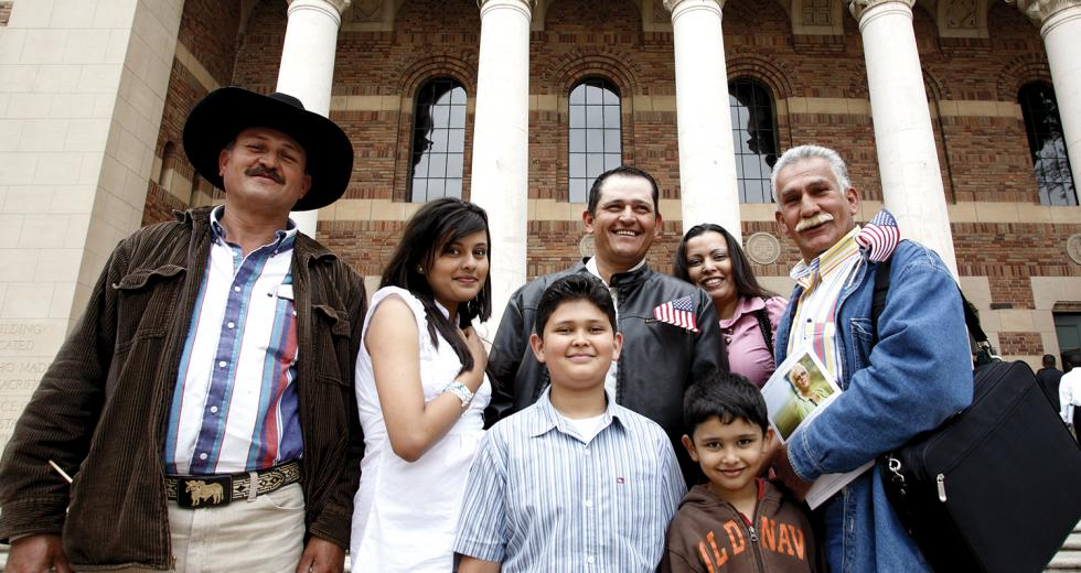 Mexican national Yulithza Ortiz (center) strands outside the Memorial Auditorium surrounded by family after his U.S. citizenship ceremony last month.