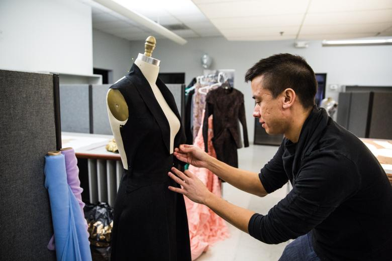"In preparation for Sacramento Fashion Week, Kouri is putting in long hours. ""It's crazy. I'm thinking, 'Why am I doing this?' I could just not be doing anything and sleep in,"" he says. But he says his passion is more important than the extra zzzs. ""It doesn't matter how prepared you think you are, you can still end up stitching designs until the last minute."""