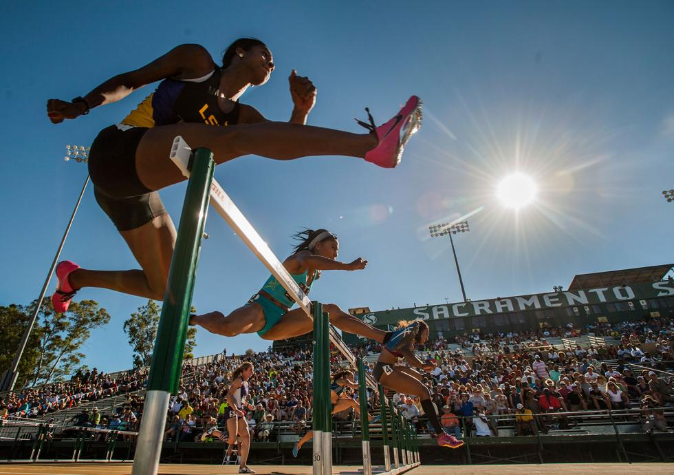 Women compete at Sacramento State's new track, a contribution of the Sacramento Tourism Marketing District.