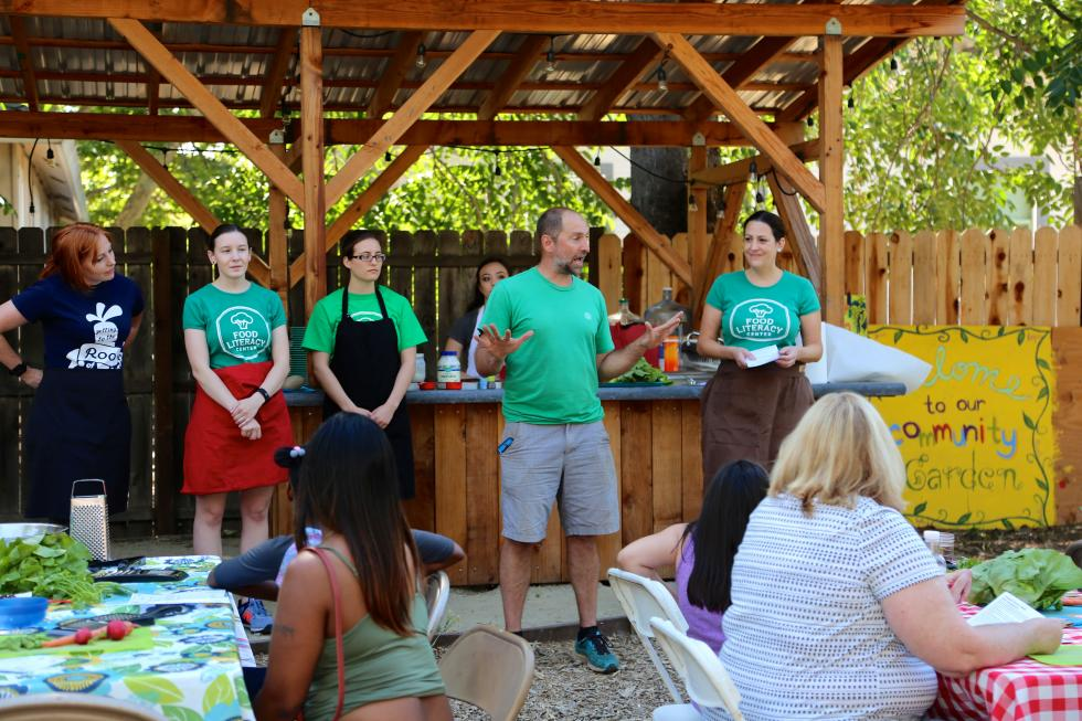 Randy Stannard, of Oak Park Sol, introduces guests from the Food Literacy Center before a cooking class. (Photo courtesy Joan Cusick)