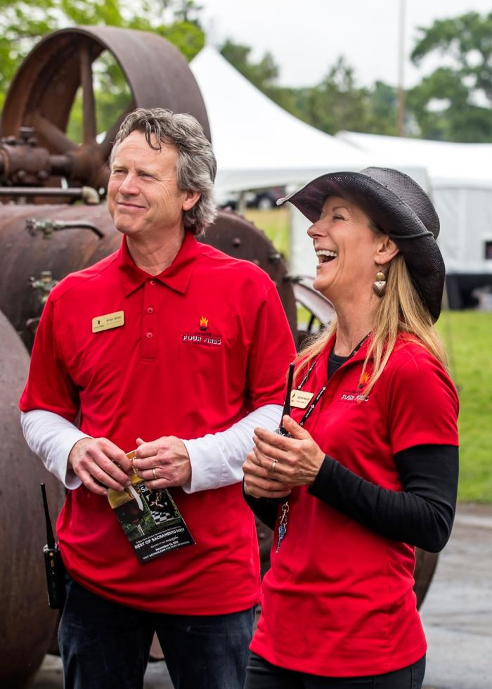 Brian Miller and Deidre Mueller, who also own Amador360 and run the Barbera Festival, take a break from managing the sold-out, second annual Amador Four Fires Festival.