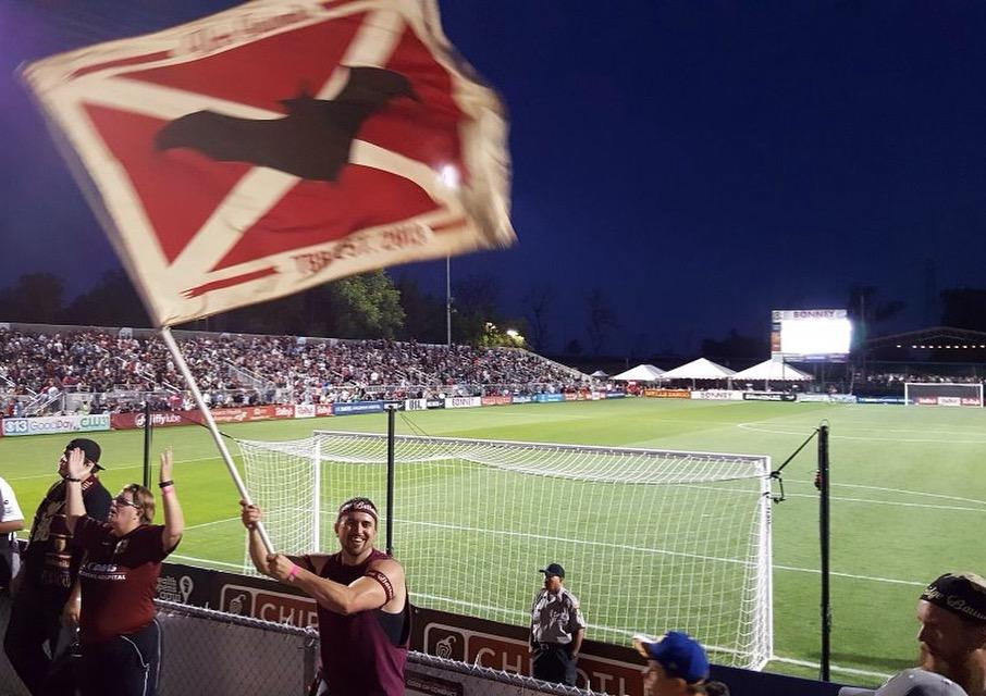 Tower Bridge Battalion member Jon Conover waves a Republic FC flag at a recent game. (Photo courtesy of Jon Conover)