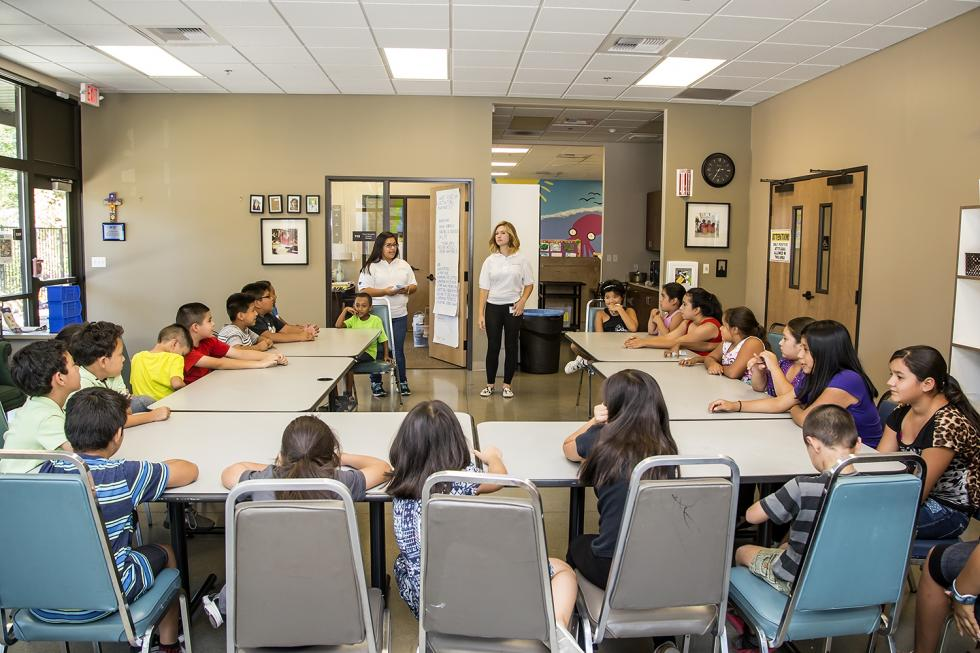 Interns Margarita Armijo (left) and Camryn Agnello encourage children to introduce themselves to other summer camp attendees.