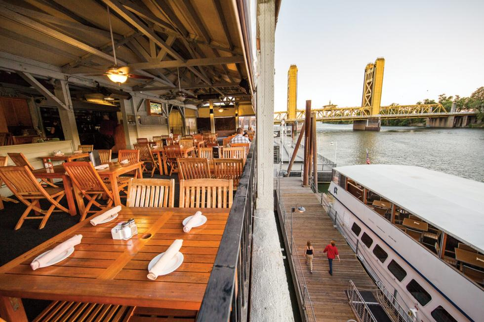 Diners on the patio of Rio City Cafe enjoy a view of the Sacramento River.
