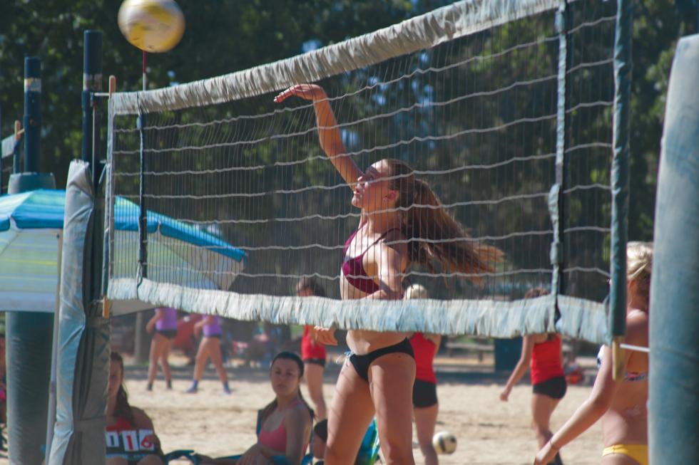 Kendall Kott plays in a beach volleyball tournament in  Sacramento. Kendall, 15, is an elite volleyball player and swimmer. (Photo by Cole Allen)