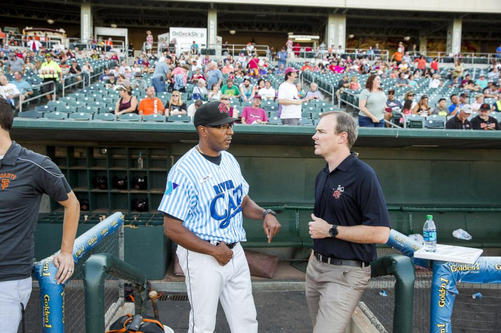 Left to Right Sacramento River Cats Manager Jose Alguacil chats with President Jeff Savage before the start of the game.