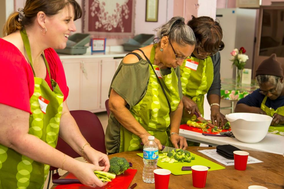 Leah Yadon (left), Vivian Walthall and Fredonia Phillips chop broccoli during the cooking demonstration at the Co-Op Community Kitchen.
