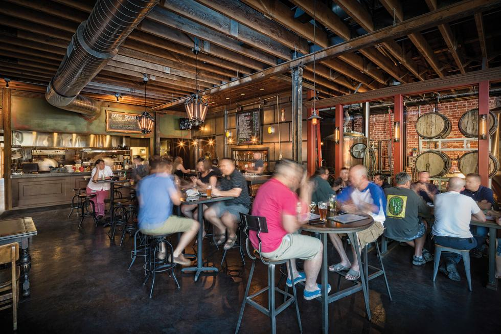 Oak Park Brewing Co.'s interior dining space melds the historic elements of the building with modern taste; dark woods complement copper and glass for a comfortable yet utilitarian feel.