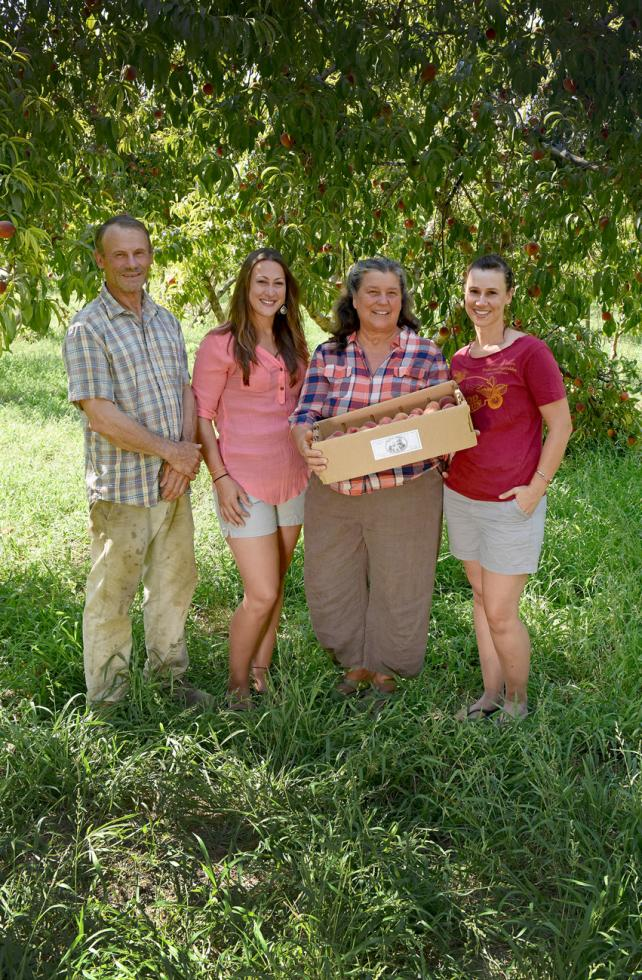 From left: Jeff, Claire, Annie and Alison Main in their peach orchard at Good Humus Produce in Capay Valley.