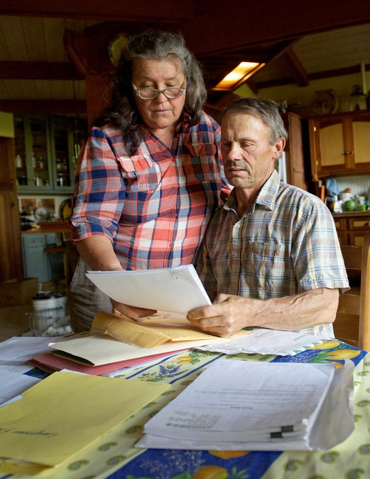 Annie and Jeff Main, of Good Humus Produce, examine paperwork for securing a conservation easement for their farmland