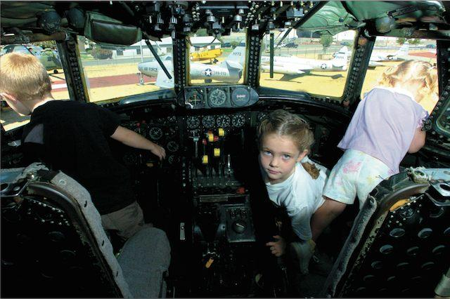 Sept. 2004: Rio Linda residents Conner and Kaylee Logan check the view from the cockpit of an Air Force EC-121 aircraft. The plane, which did coastal radar patrol during the Cold War era, is one of many retired aircraft on display at the McClellan Aviation Museum