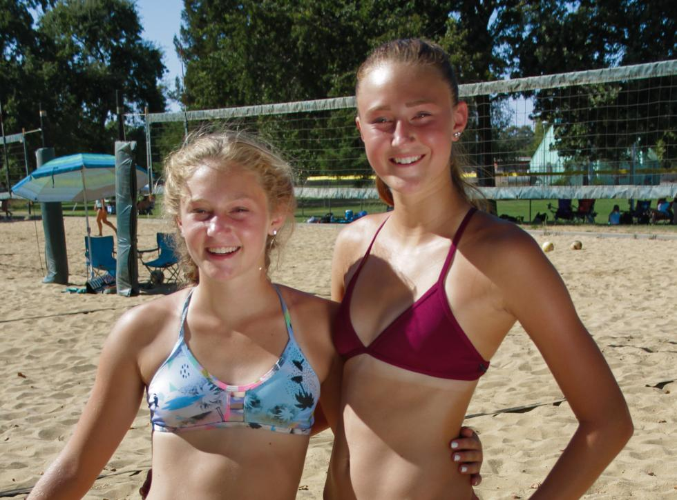 Lauren (right) and Kendall Kott take a break during a recent beach volleyball tournament in Sacramento. (Photo by Cole Allen)