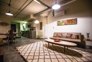 Units in the renovated industrial space at Warehouse Artist Lofts feature exposed ductwork, original concrete columns and period-appropriate light fixtures.