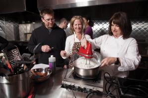 Paulette Bruce (far right), owner of Good Eats Cooking Classes, teaches a Sunday morning group at East Bay Restaurant Supply.