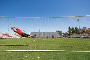 Dominik Jakubek, one of two goalkeepers for Sacramento Republic FC, makes a diving save on a shot during practice at Bonney Field. Jakubek joined the franchise as an original member in 2014. He was 34 years old when he was signed.