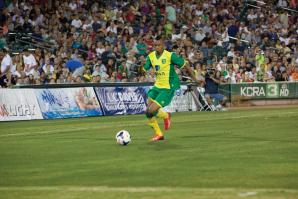 Nathan Redmon from Norwich City F.C. carries the ball during his team's friendly match at Raley Field during Sacramento Soccer Day on July 18, 2013.