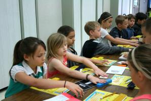 Students feel examples of braille during an ATOU workshop. (Photo courtesy Meghan Adamski)