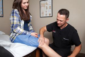 Dr. Hunter Greene, orthopedic surgeon, examines a patient at Summit Orthopedic Specialists in Carmichael.