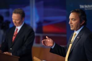 Newly elected Congressman Ami Bera, a Democrat (right), debates Republican opponent Dan Lungren, whom Bera ousted from California's 3rd Congressional District seat in the November 2012 election.