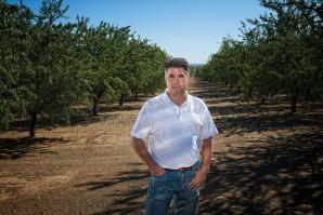 Keith Fichtner, project manager for Dunnigan Land Development Trust, plans to build 8,000 homes on the site of this almond orchard and nearby agricultural land.