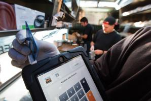 Drewski's Hot Rod Kitchen uses Square, a mobile credit card reader, to process customer payments on location.