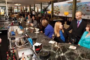 Although vacancies at the Sheraton Grand have increased the past few years, the lobby's bar has maintained business.