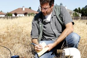 Derek Jacks, an environmental specialist for Sacramento County, spends a few hours of each workday searching for and documenting abandoned wells.