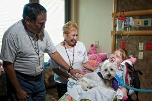 Heather Phillips has been in the hospital for nearly five years. She is visited regularly by Sherm and Sandy Waldman and their West Highland white terrier as a part of a palliative care program at Sutter Roseville Medical Center.
