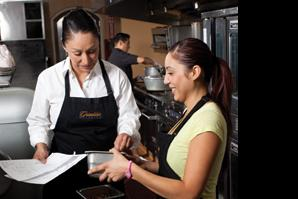 Griselda Barajas (left) provides health care insurance to her 10 employees at Griselda's Catering in Sacramento. Her small business is in the minority of those that can offer such benefits.