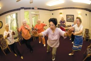 Residents of the Chateau at River's Edge participate in a Tai Chi class.